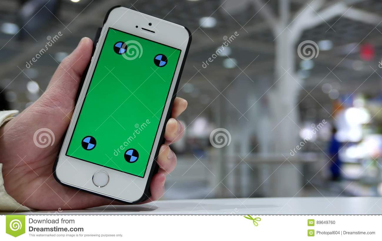 woman holding green screen iphone with blurry restaurant stock footage video of green connection 89649760