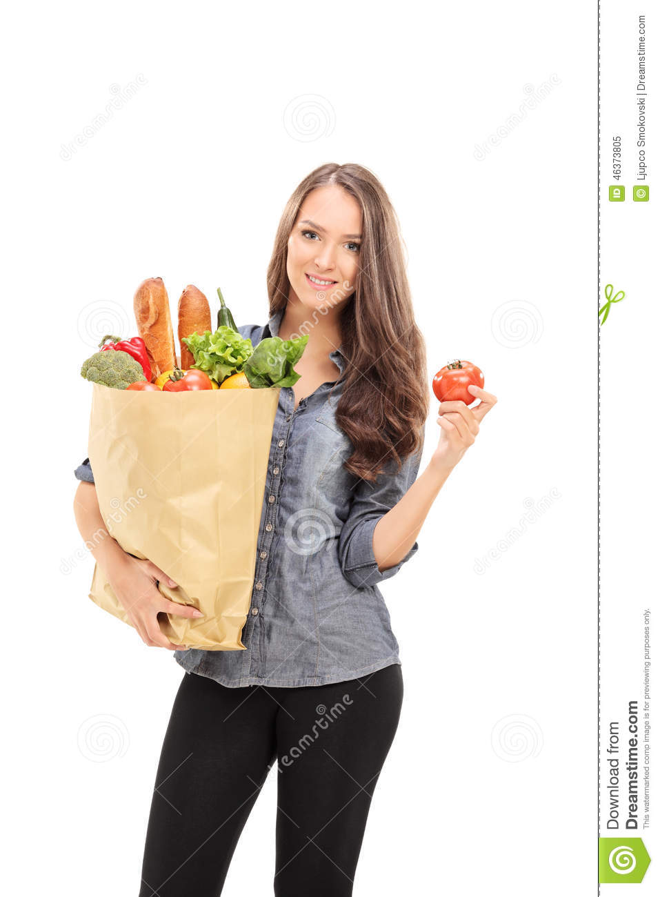 Woman holding grocery bag and a single tomato
