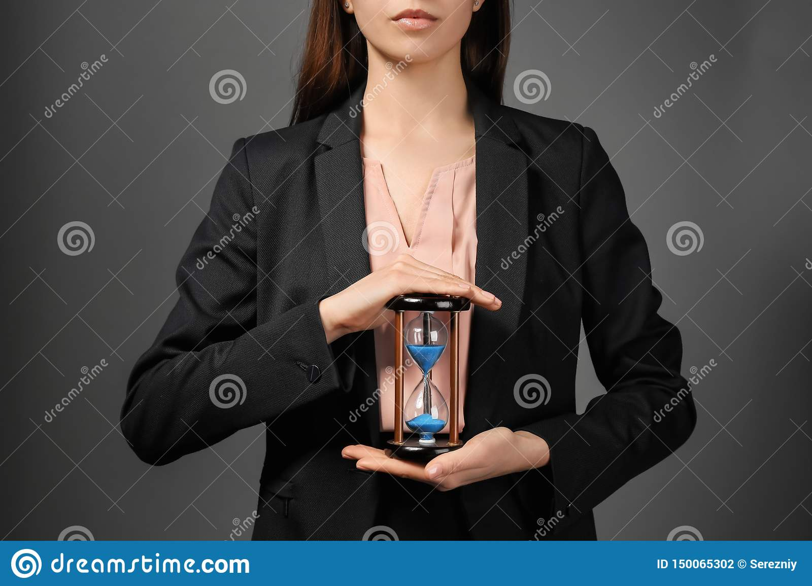 Woman Holding Hourglass On White Background. Time
