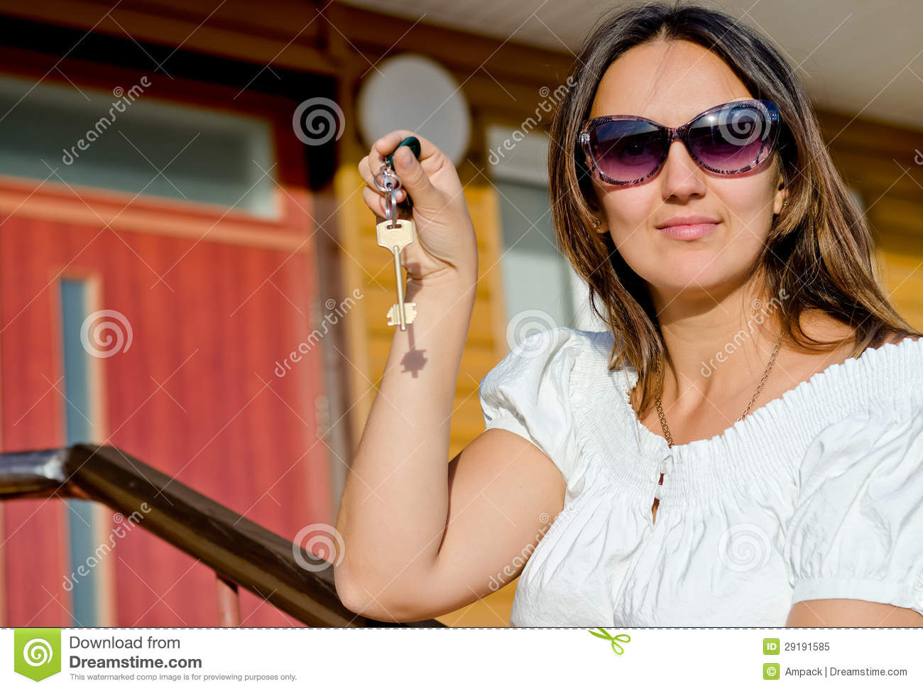 Woman Holding A House Door Key Royalty Free Stock Photo