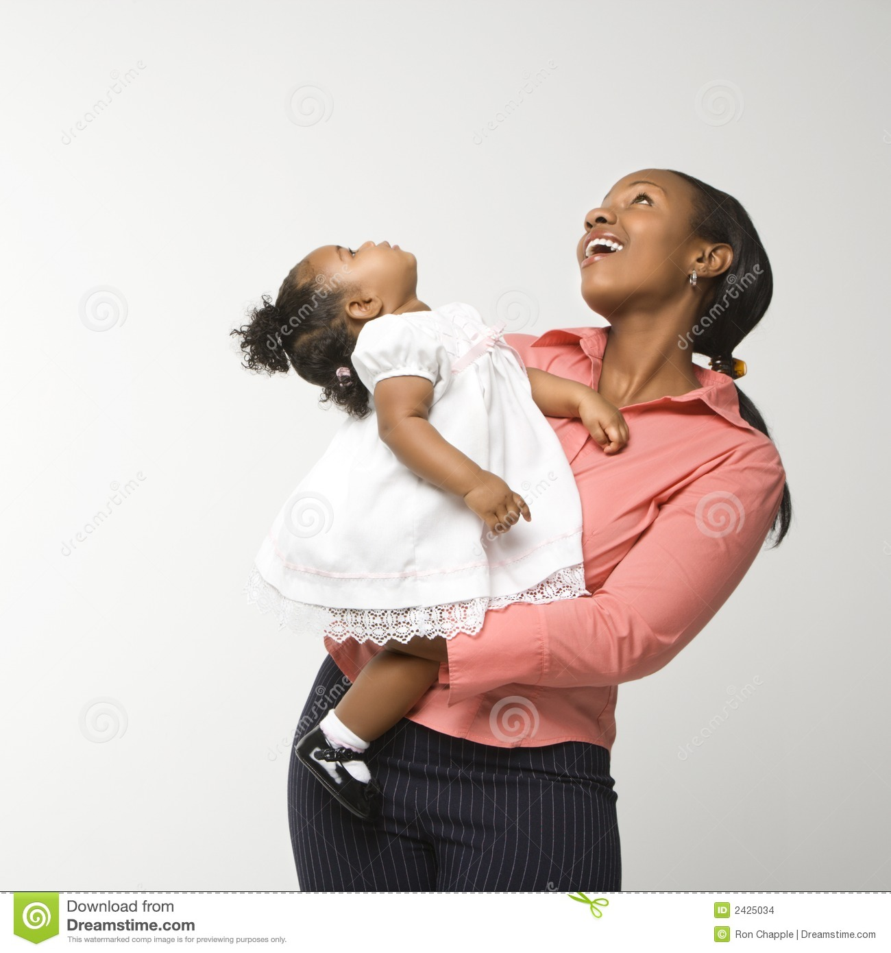 Woman holding infant girl.