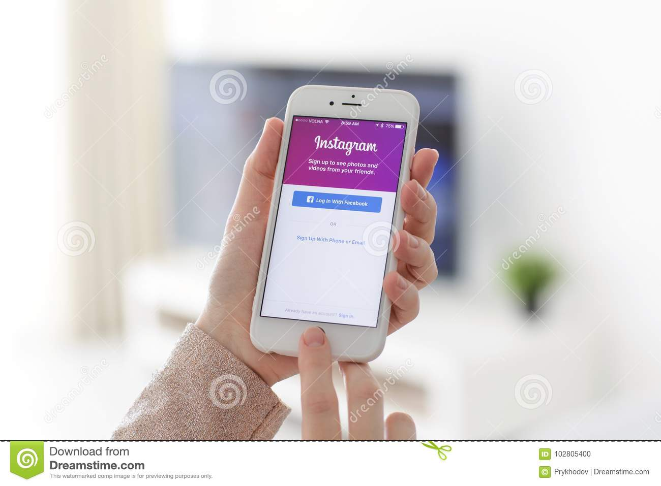 Woman Holding IPhone With Social Networking Service