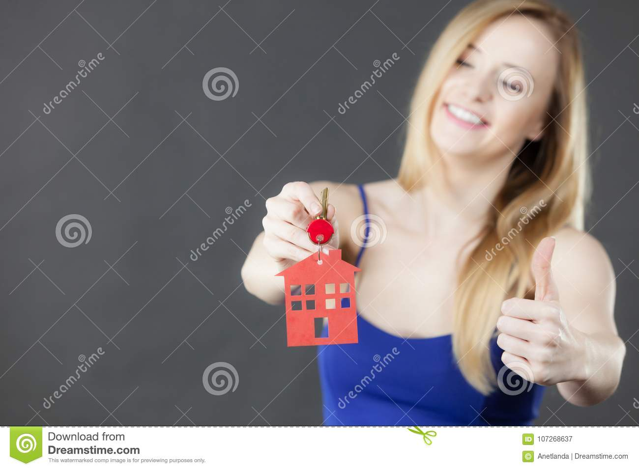 2077cefe6b Woman Holding Key With House Symbol Stock Image - Image of success ...