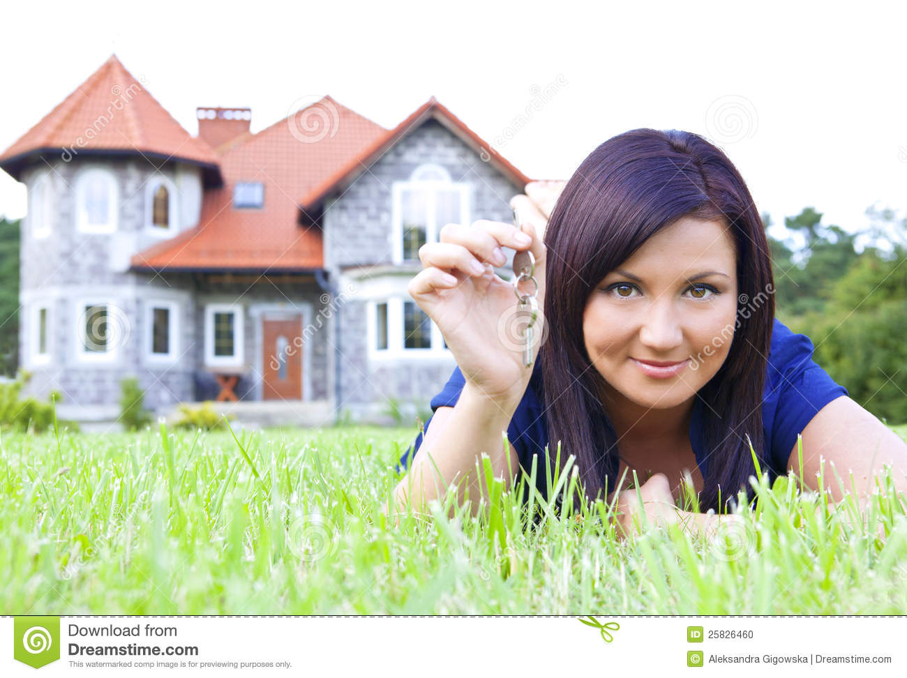 woman holding keys to house 25826460