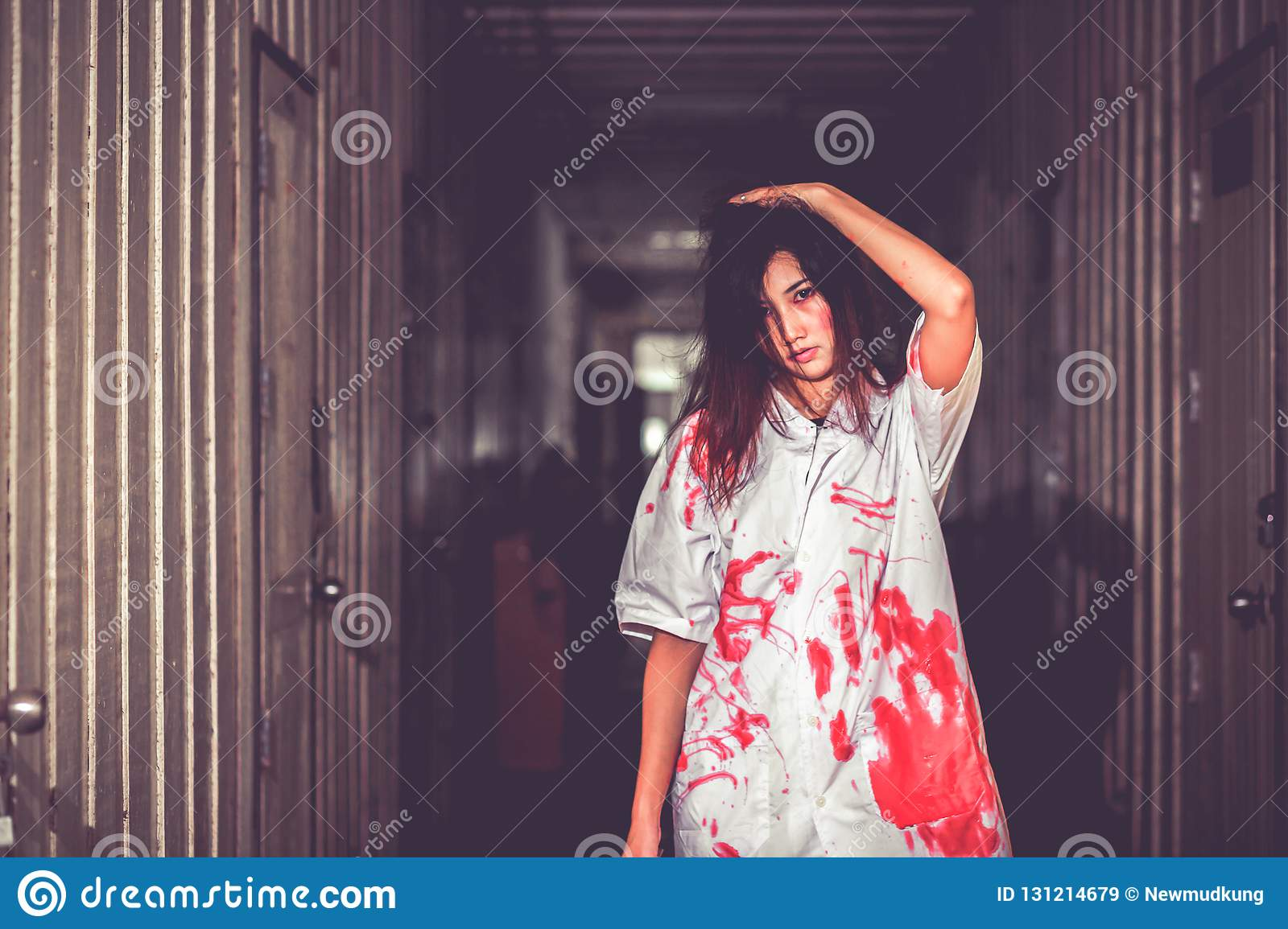 A Woman holding knife with blood, halloween concept.