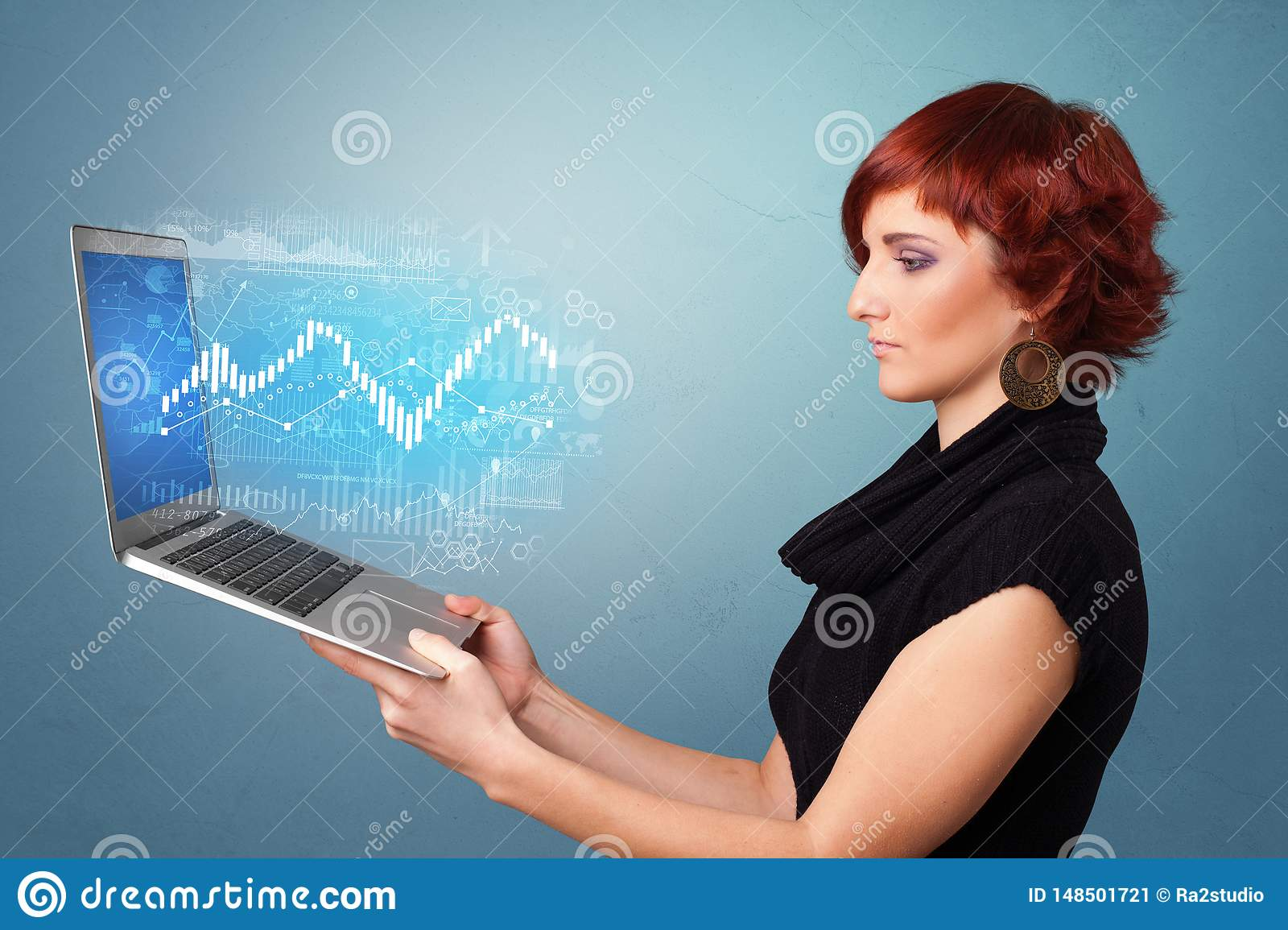 Woman holding laptop with financial concept