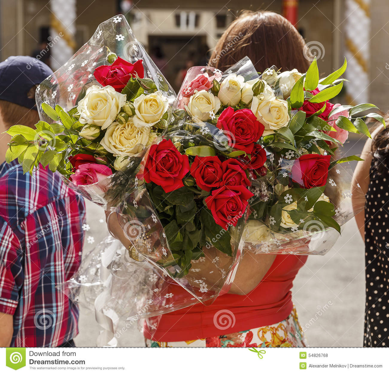 A Woman Holding A Large Bouquet Of Roses (back View) Stock Photo ...