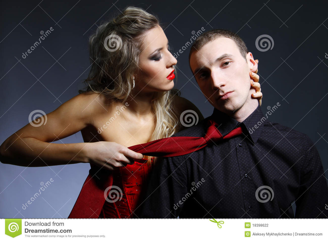 http://thumbs.dreamstime.com/z/woman-holding-man-tie-18398622.jpg