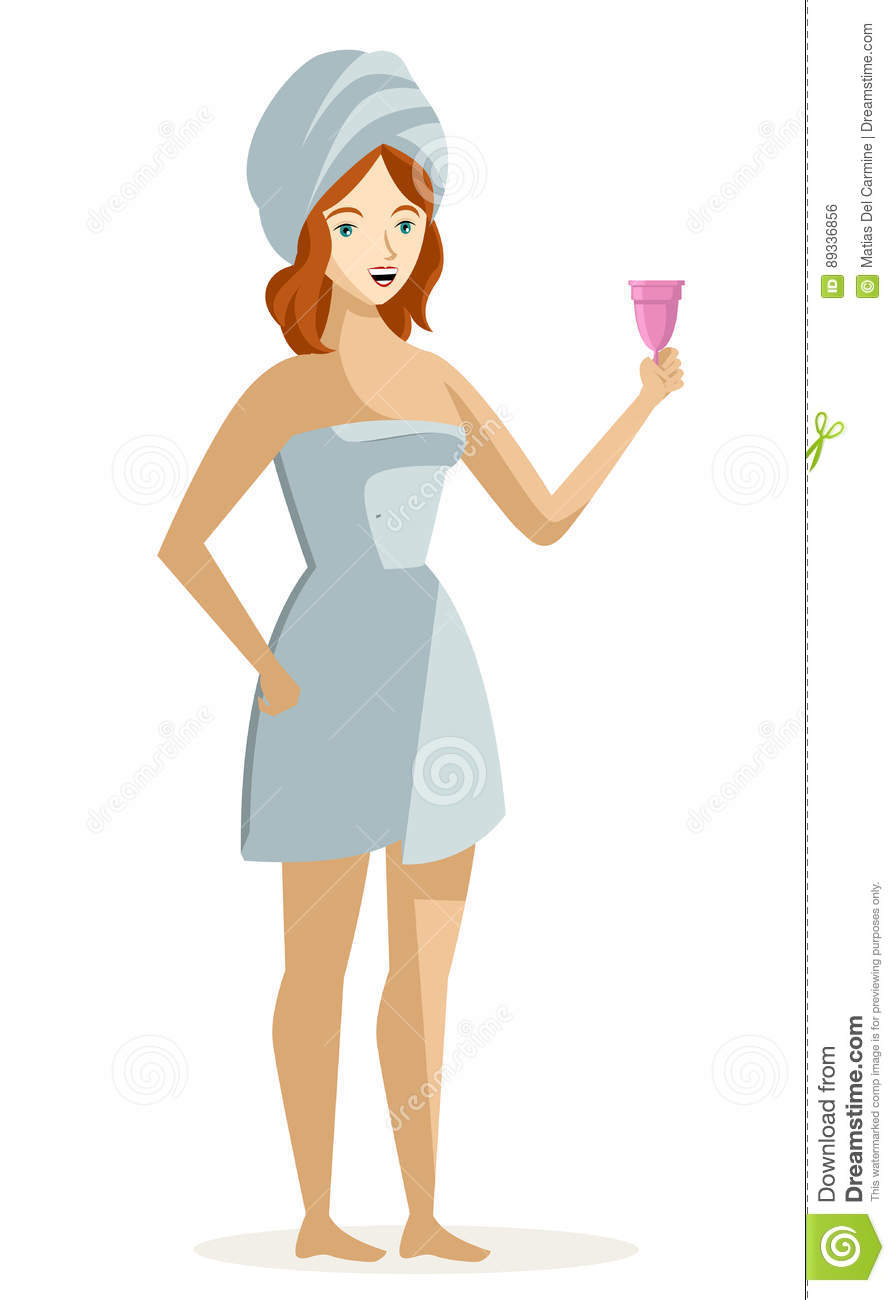 Woman holding a menstrual cup after a shower