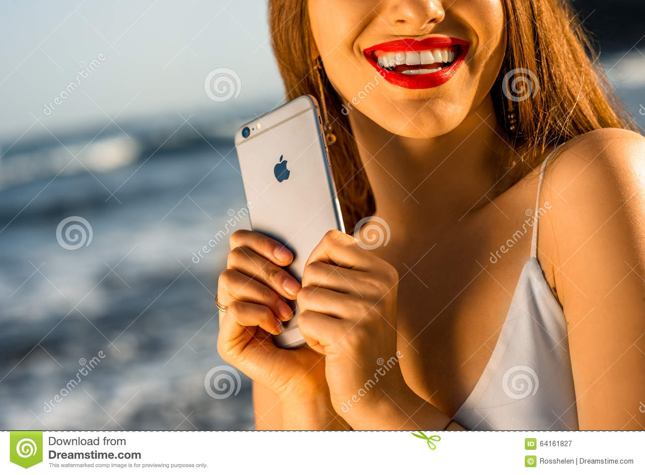 naked girl holding iphone