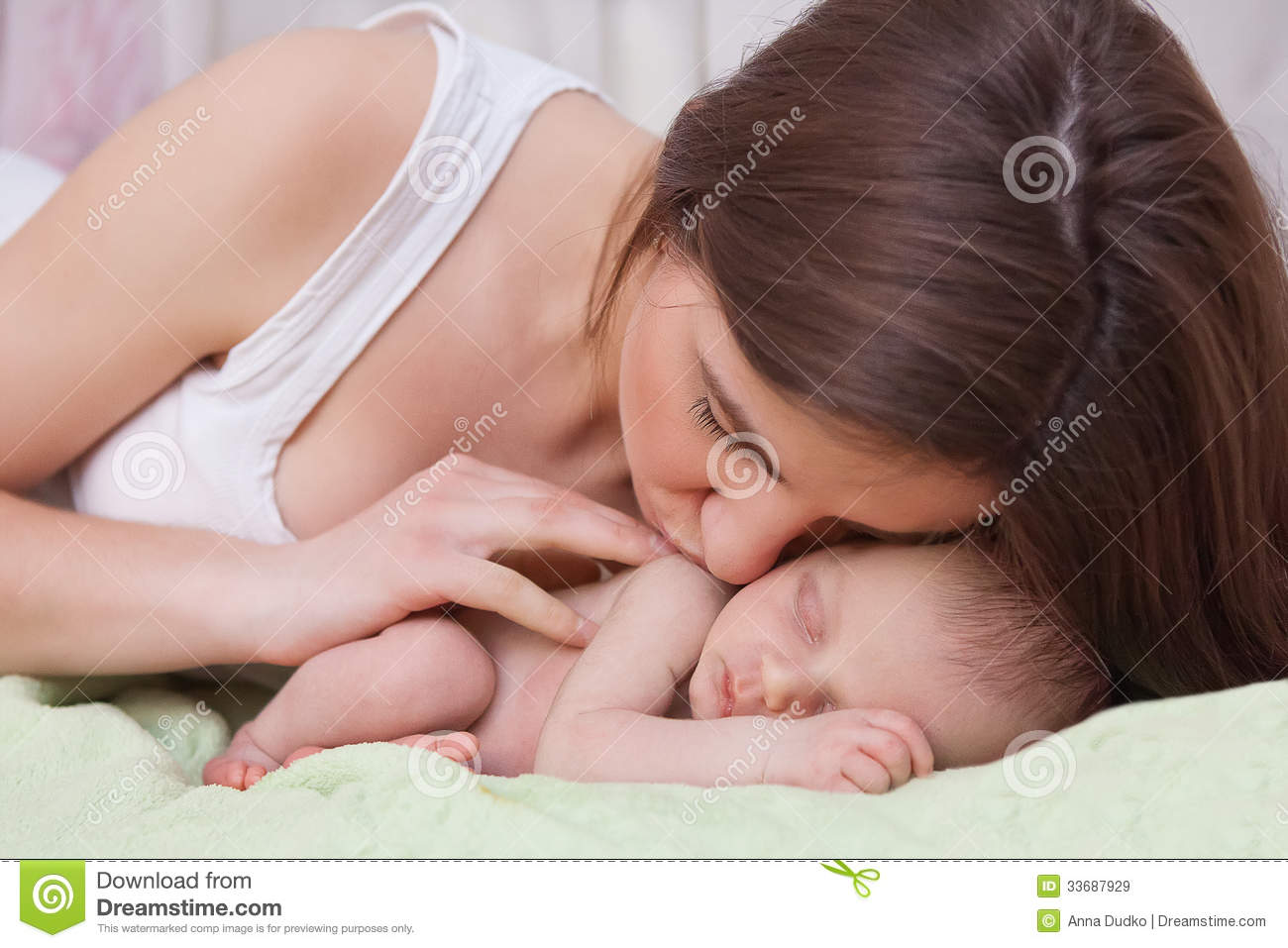 Woman Holding And Newborn Baby Stock Image - Image: 33687929