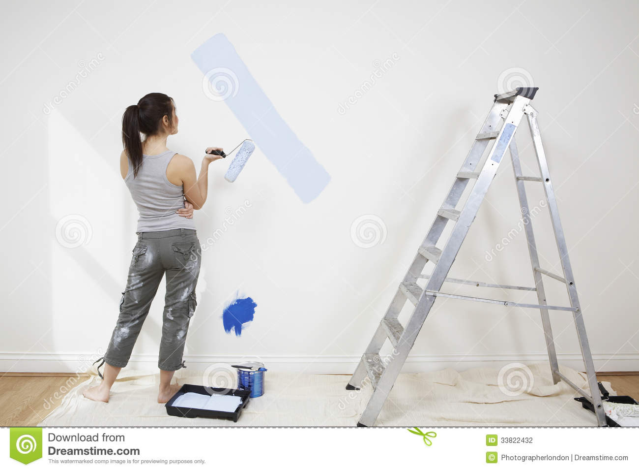 woman paint on wall royalty free stock photo - image: 15915935