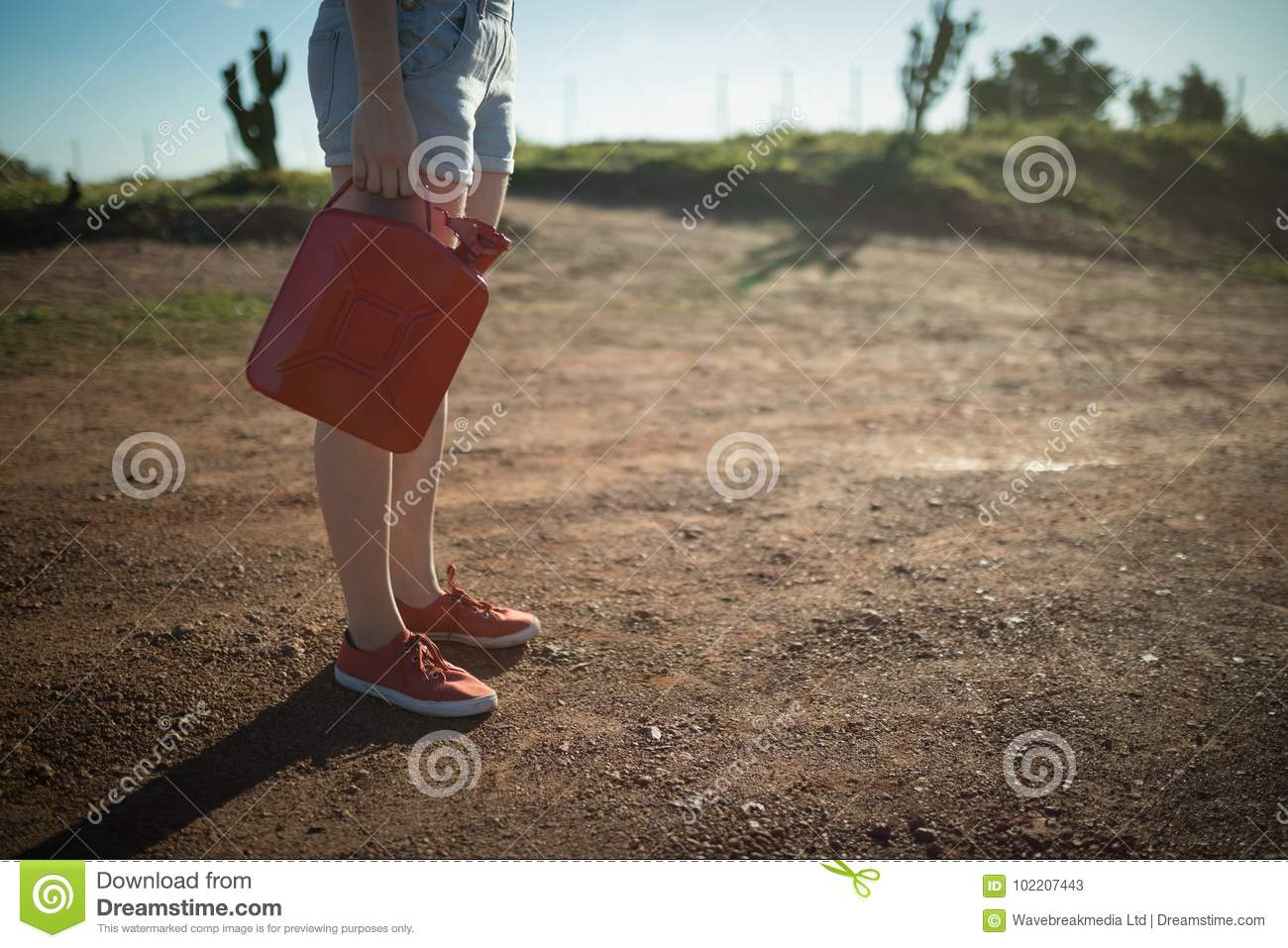 Woman holding a petrol can