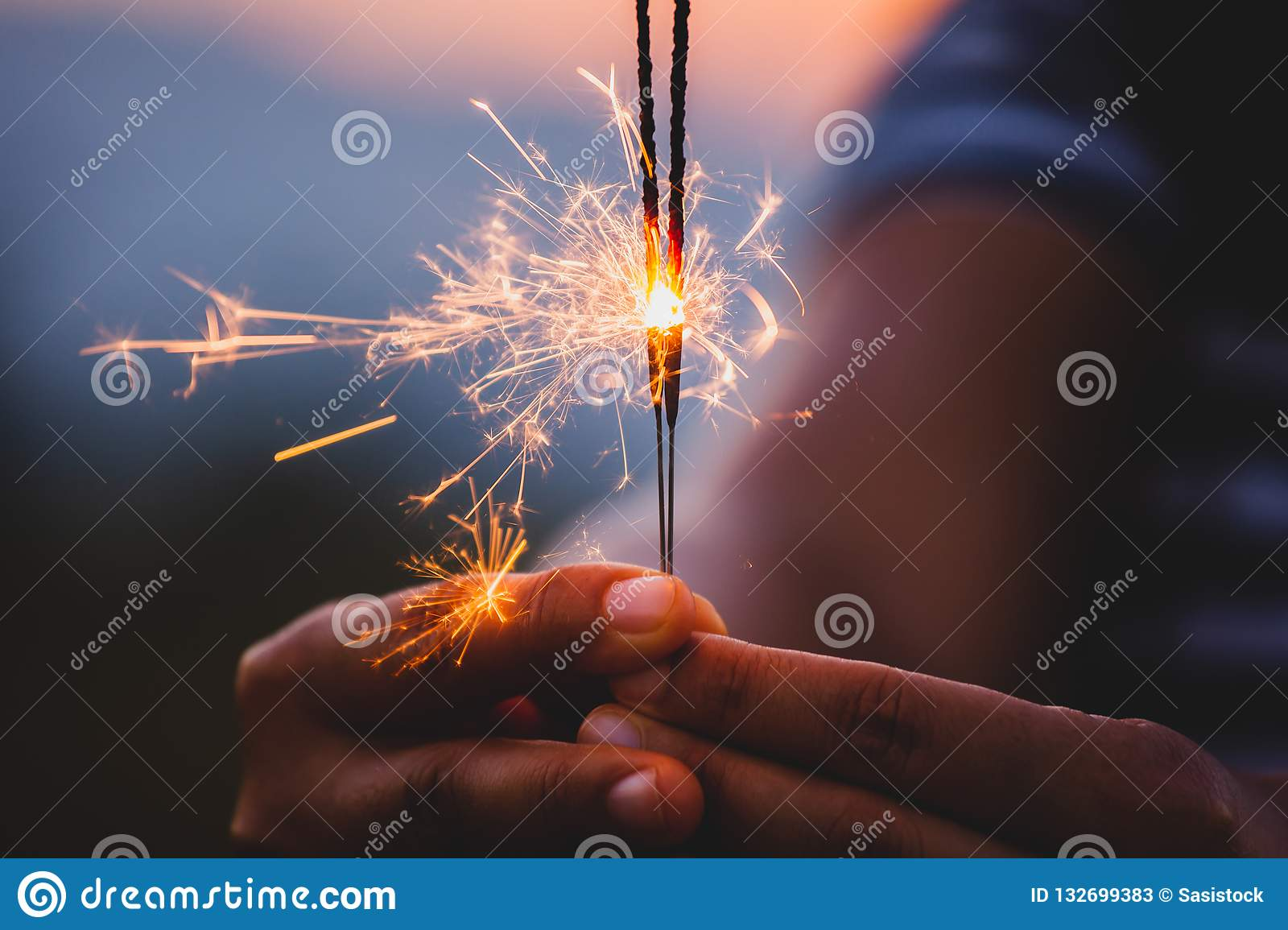 Woman Holding And Playing With Fire Sparklers On The