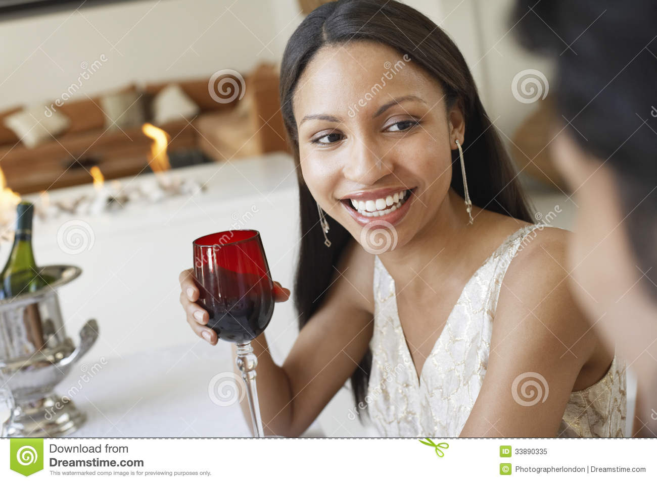 Woman Holding Red Wine Glass At Dinner Party Stock Image ...