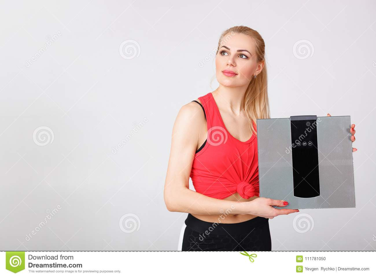 Woman holding scales in hands