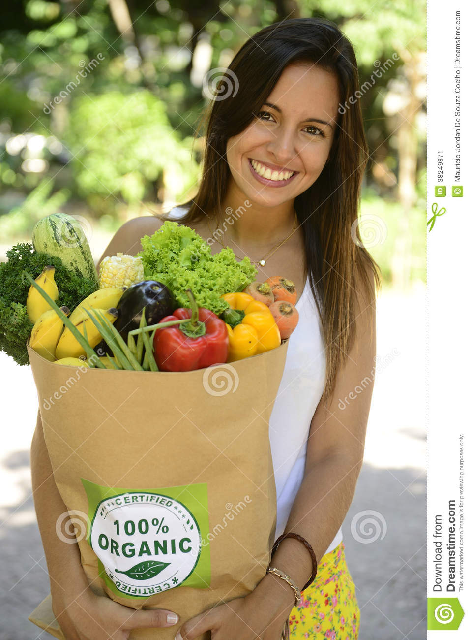 Woman holding shopping paper bag with organic or bio vegetables and fruits.