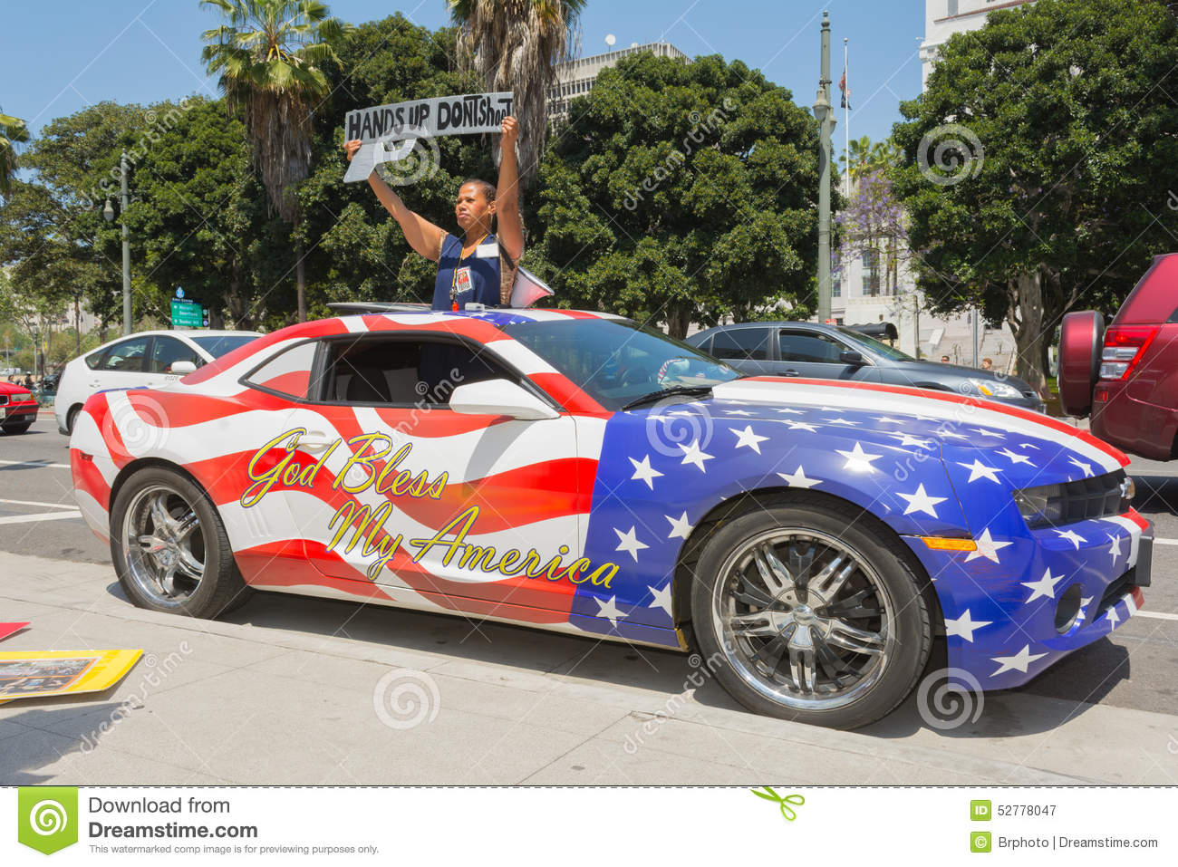 woman holding sign next to a car painted in american flag colors editorial photography image. Black Bedroom Furniture Sets. Home Design Ideas