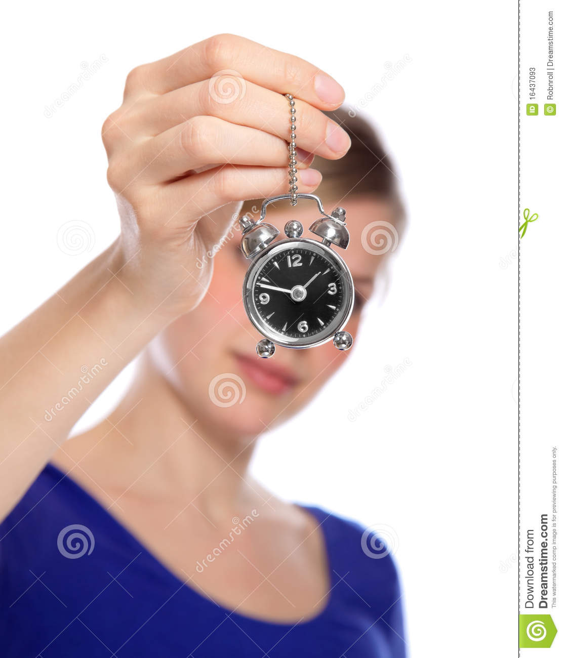 Woman holding a small alarm clock. Woman Holding A Small Alarm Clock Stock Photos   Image  16437093