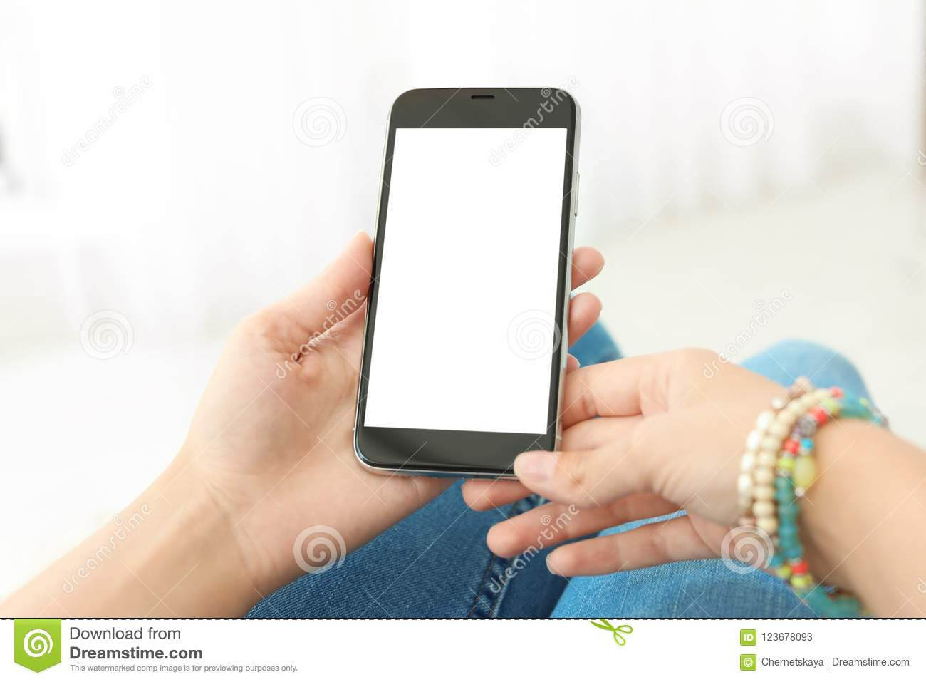 Woman holding smartphone with blank screen