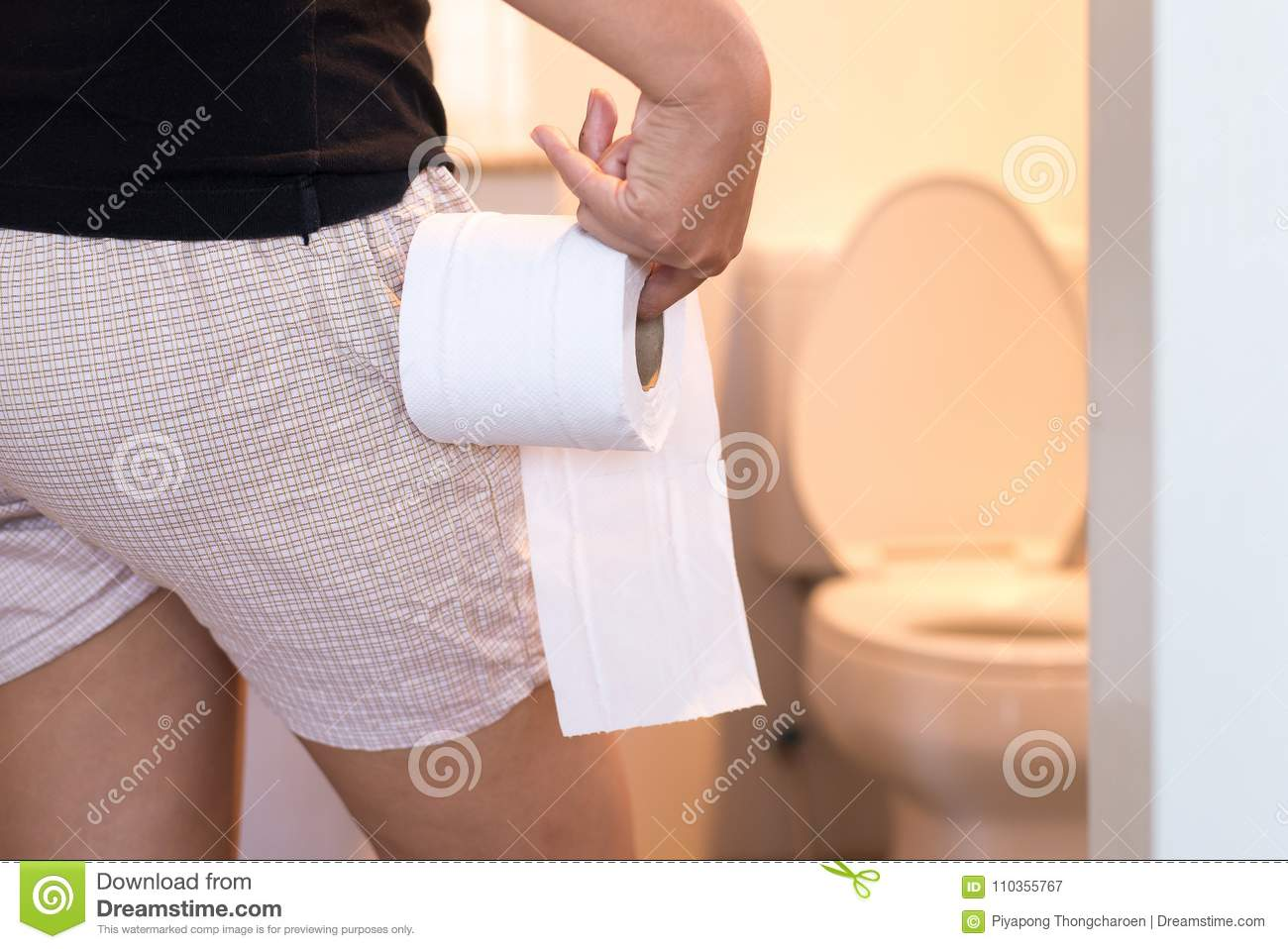 Closeup Woman Sitting On Toilet In The Morning With