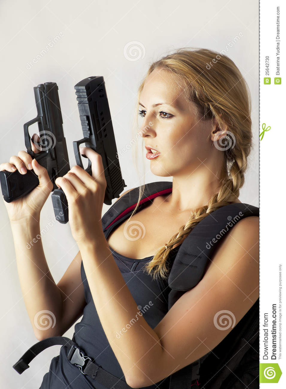 Woman Holding Two Hand Gun Stock Photo - Image: 25642730