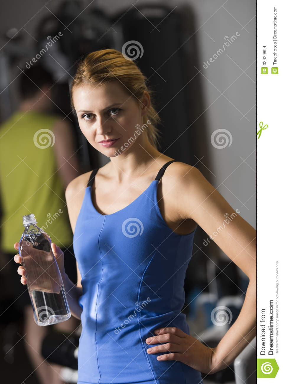 Woman Holding Water Bottle At Health Club Stock Images ...
