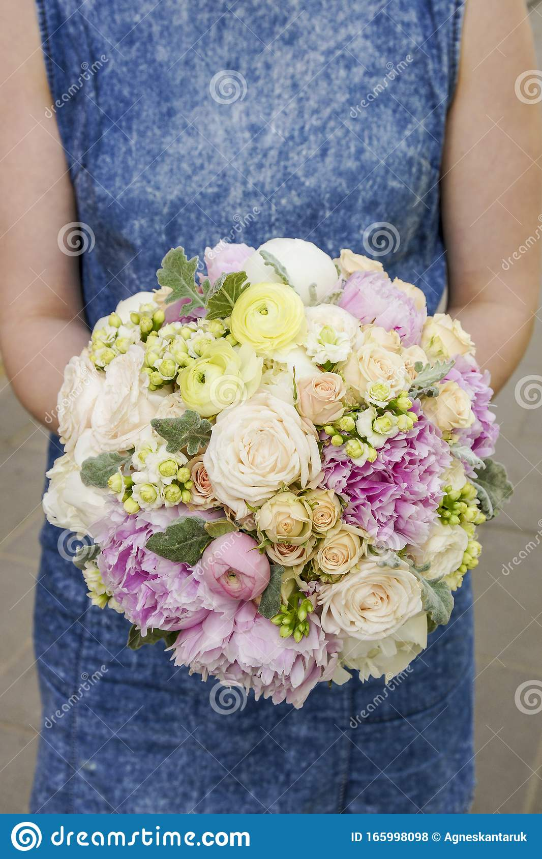 Woman Holding Wedding Bouquet With Peonies Roses And Ranunculus Flowers Stock Photo Image Of Beauty Birthday 165998098