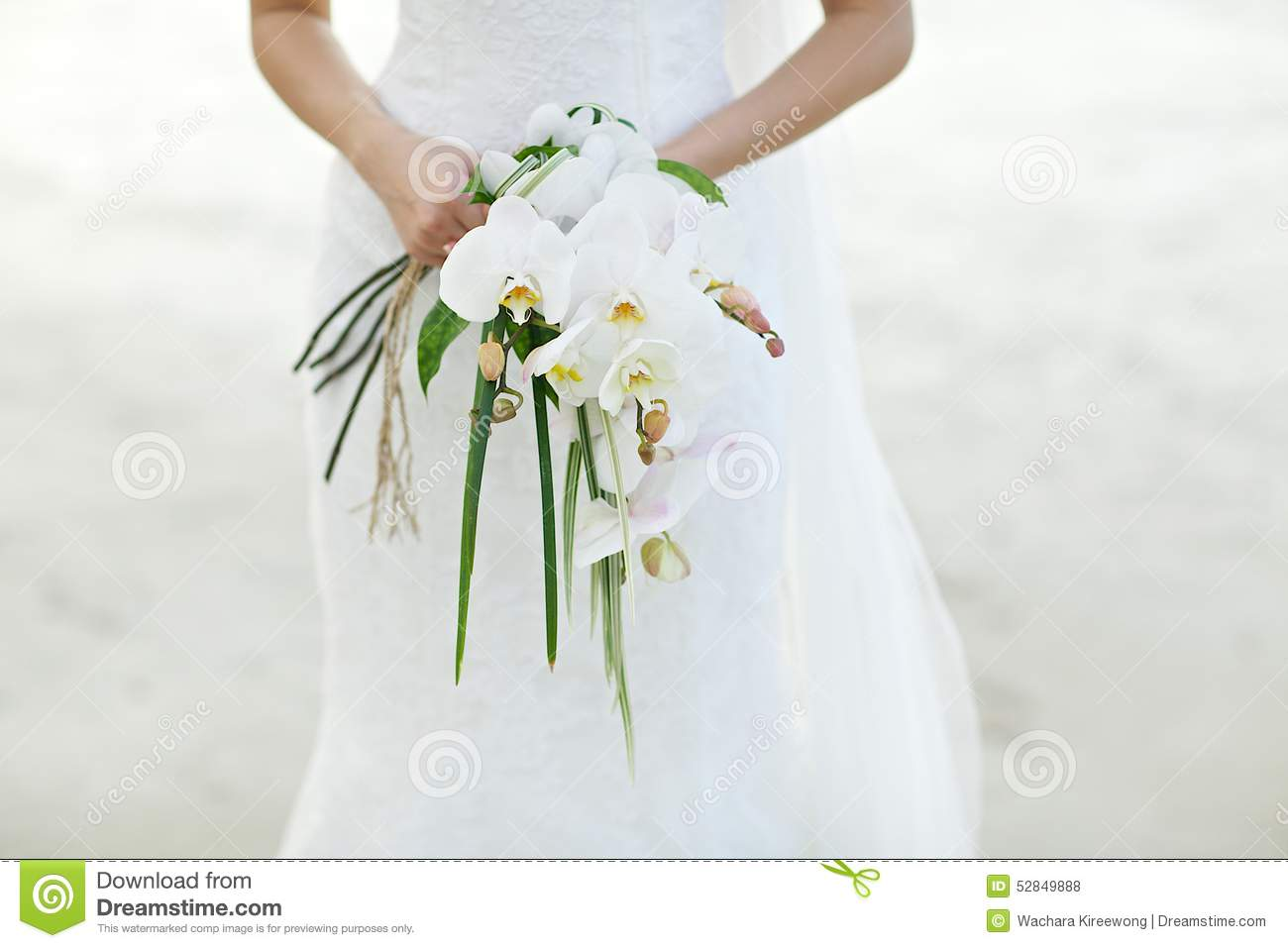 woman holding white orchid wedding bouquet with beach. Black Bedroom Furniture Sets. Home Design Ideas