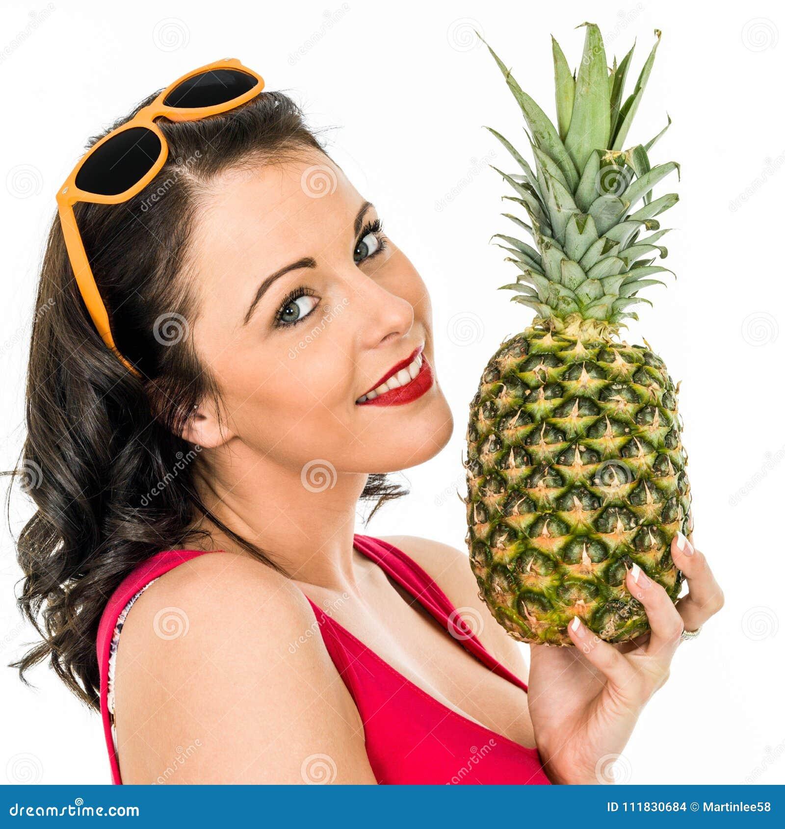 Woman Holding A Fresh Ripe Pineapple