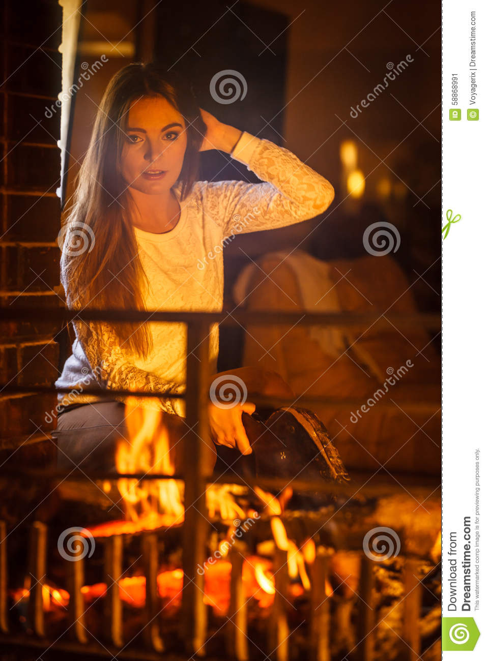 Woman At Home Fireplace Making Fire With Bellows. Stock Photo ...