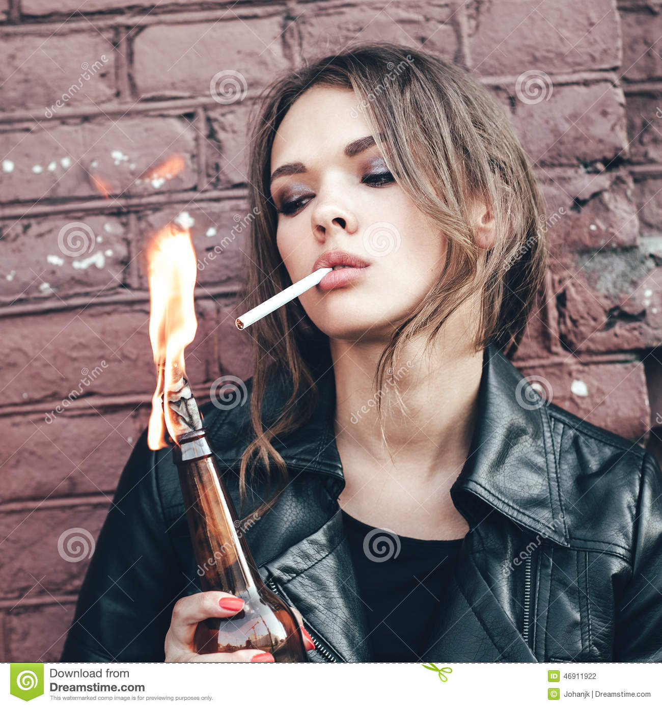 Woman Hooligan Lighting Up A Cigarette From Molotov Cocktail Bomb In Her Hand Stock Photo ...