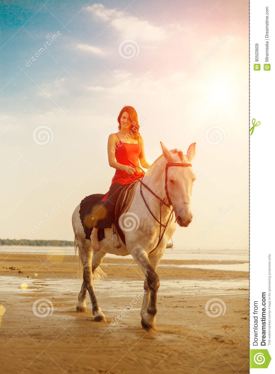 Woman and horse on the background of sky and water. Girl model o