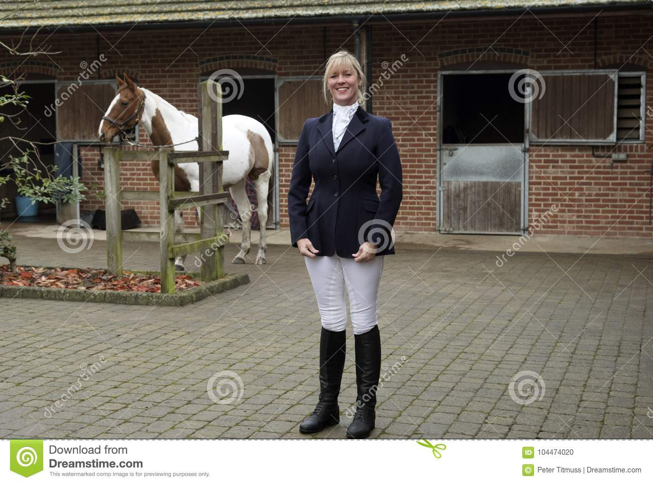 Woman Horse Rider Standing In A Stable Yard Stock Photo Image Of Blue Holding 104474020