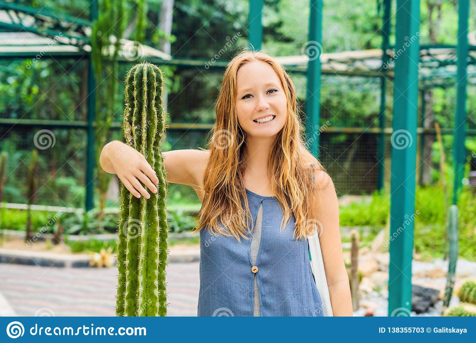 A woman hugs a cactus as her best friend. Problems of friendship concept