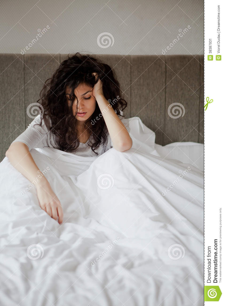 Sorrow woman with hurt feelings in bed inside bedroom in the morning