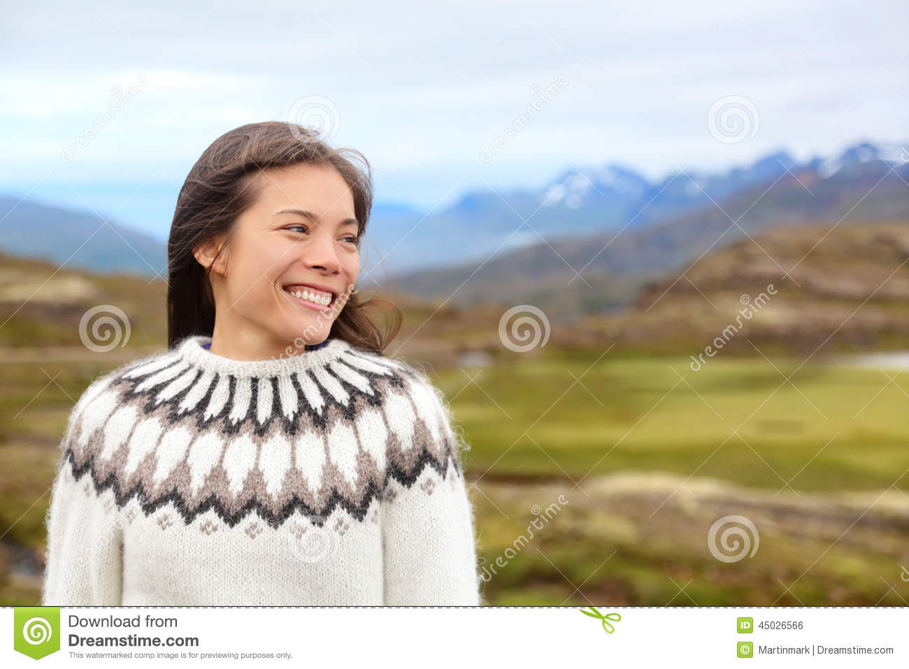 Woman on Iceland in Icelandic sweater. Portrait of girl happy smiling ...