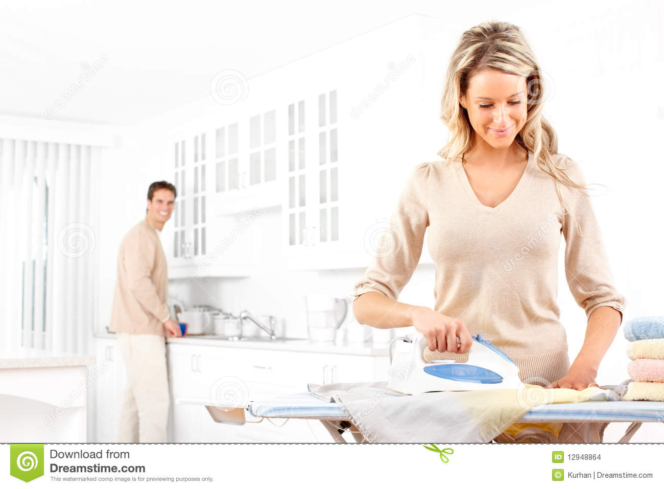 Woman Ironing Clothes Stock Images - Image: 12948864