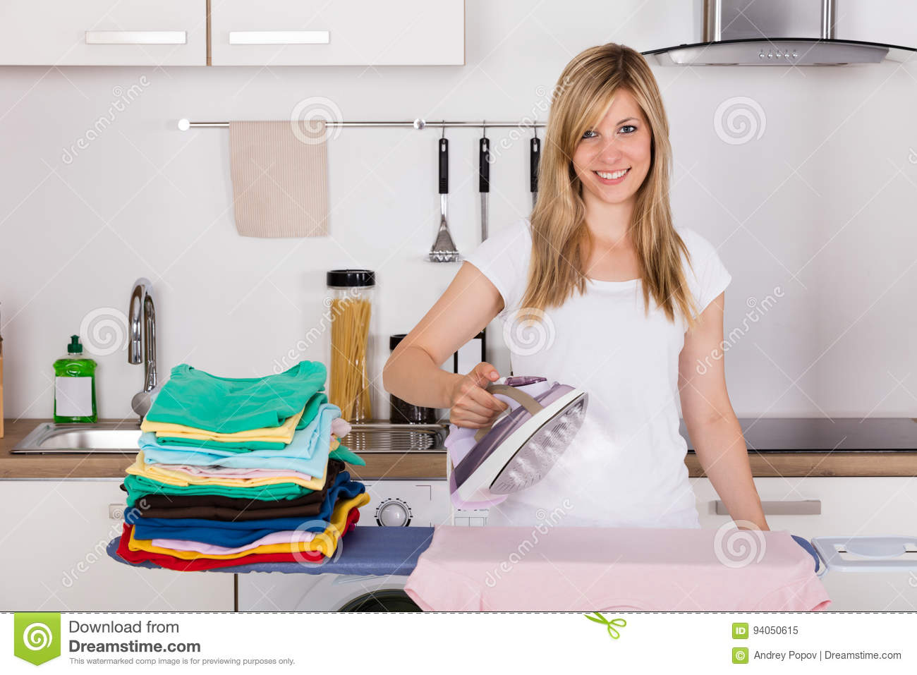 Woman Ironing Clothes With Electric Iron
