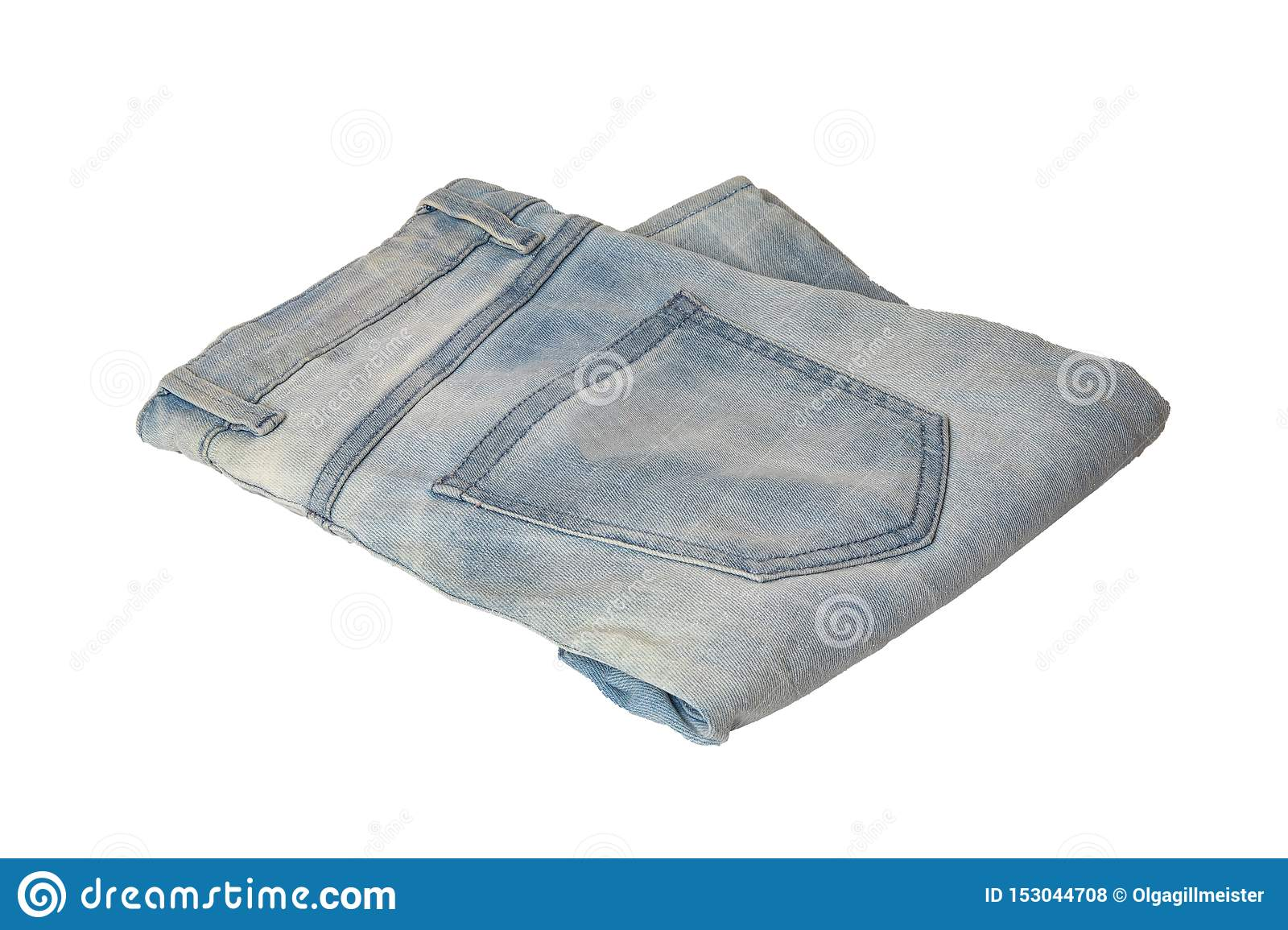 Woman jeans isolated. Folded trendy stylish female blue jeans trousers isolated on a white background. Fashionable denim pants for