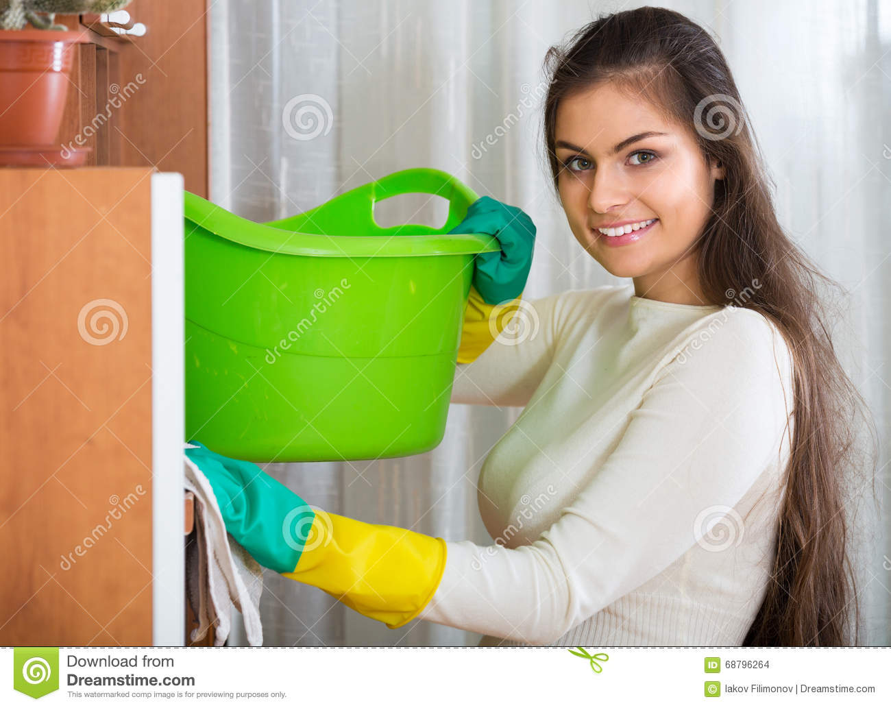 Woman in jersey cleaning furniture stock photo image for Cleaning living room furniture