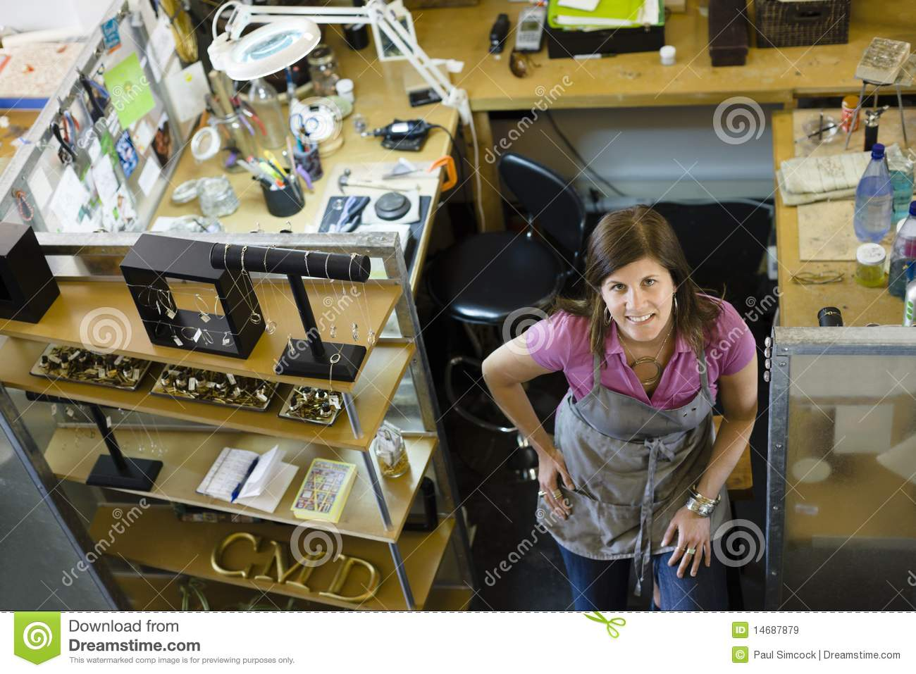 Woman Jeweller Smiling to Camera