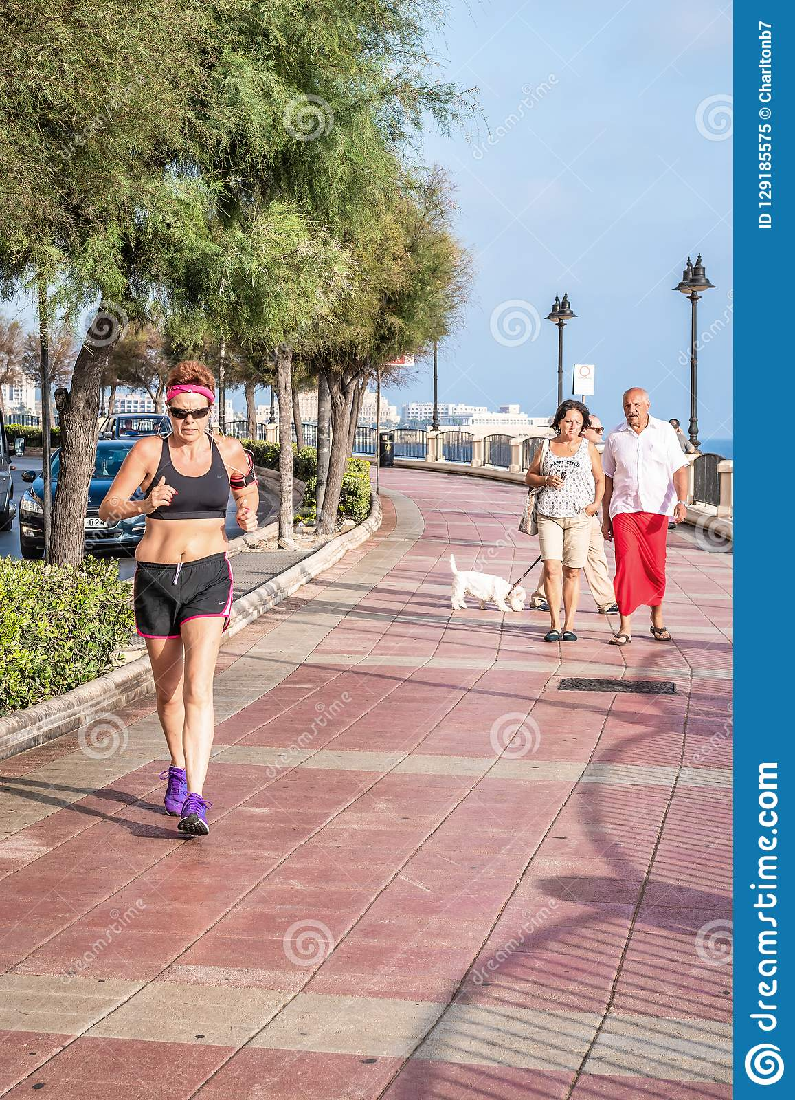Woman Jogging with sports clothes
