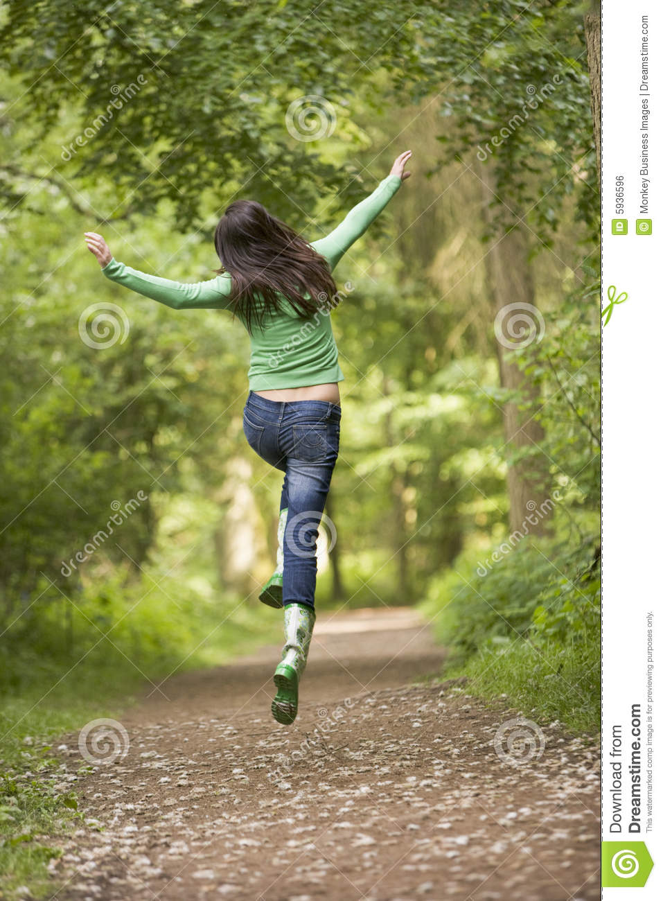 Woman jumping on path