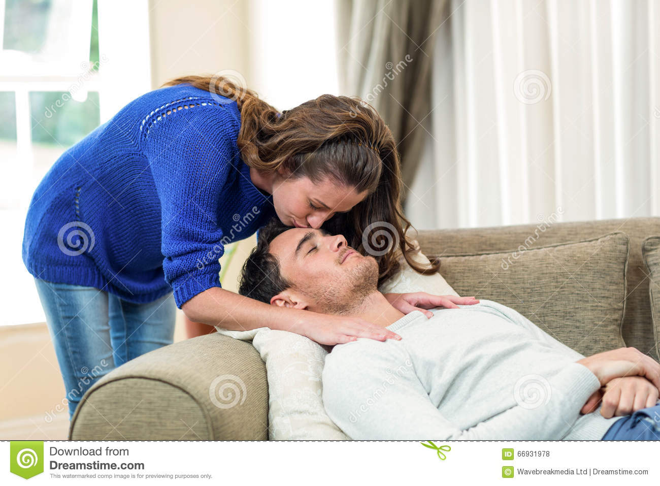 Woman Kissing On Her Mans Forehead Stock Photo - Image of