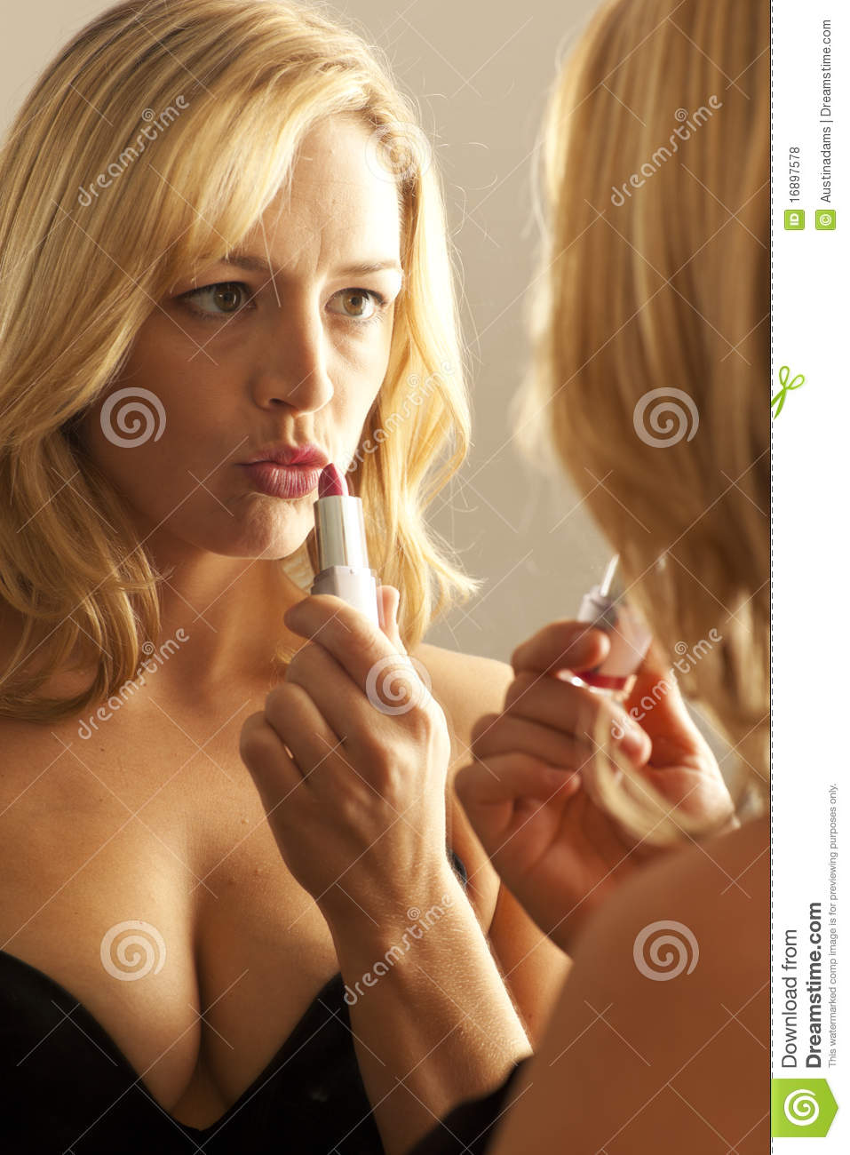 Woman Kissing Lips In Mirror After Applying Lipsti Royalty