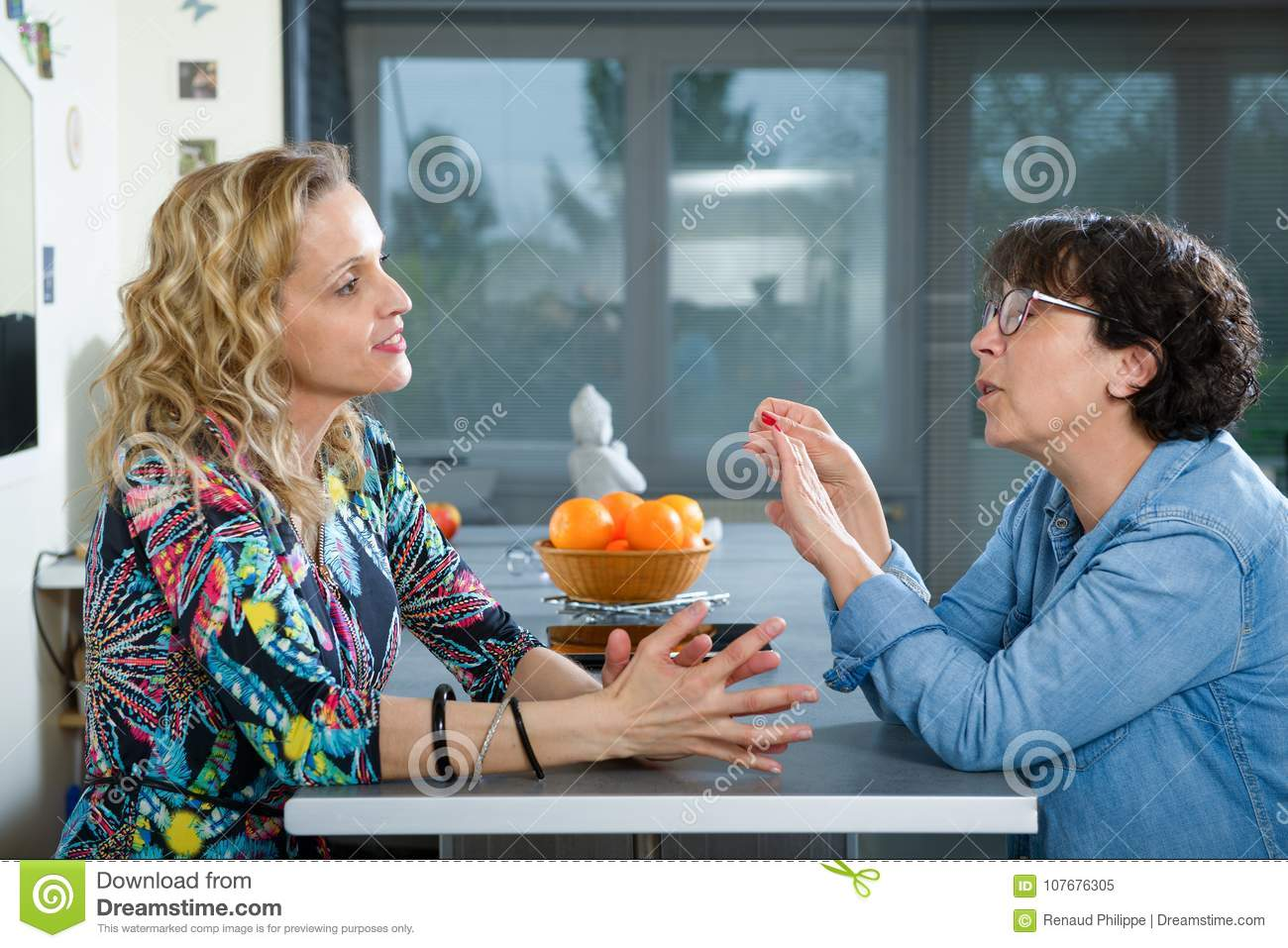 Woman In Kitchen Talking With Friend Stock Image - Image of ...