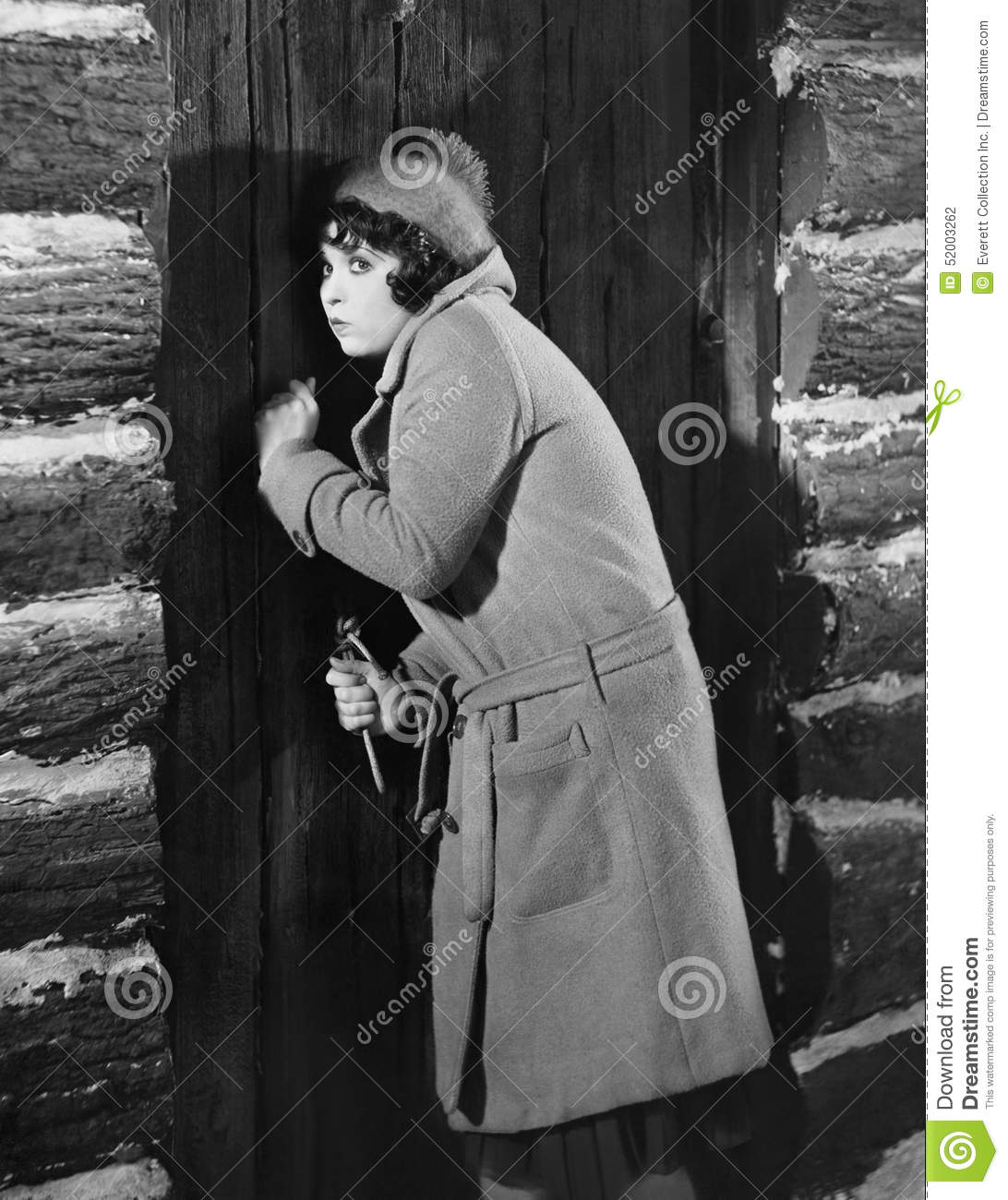 Woman Knocking On Cabin Door Stock Photo - Image of ...