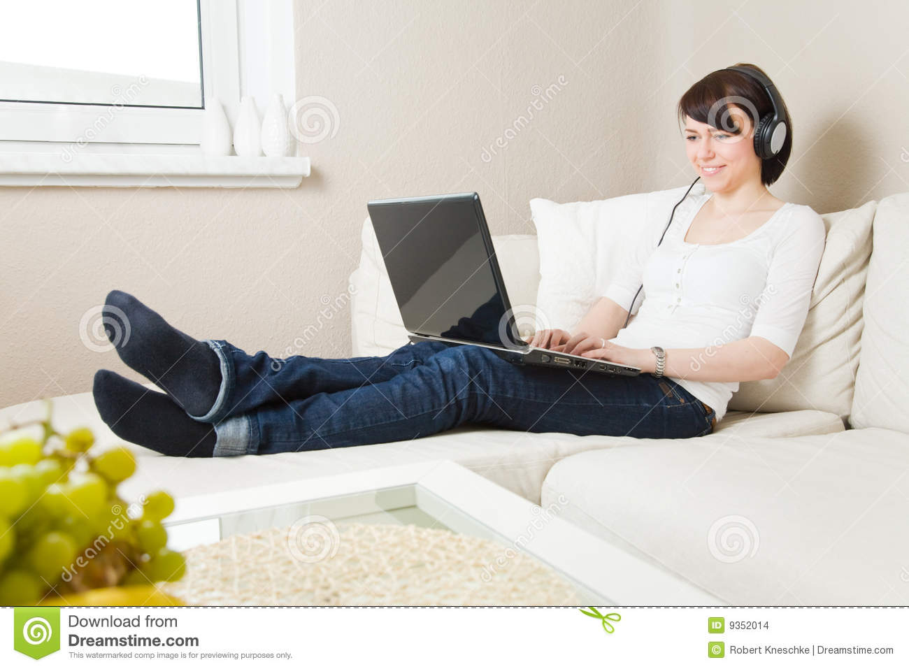Woman with laptop and headphones