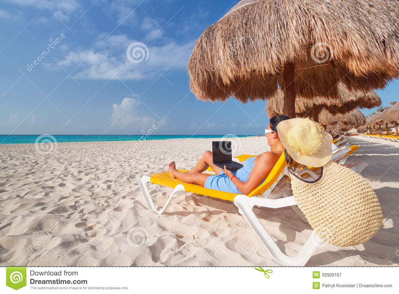 Caribbean Relaxation: Woman With Laptop Relaxing On The Deckchair Stock Image